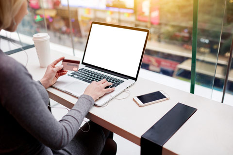 Female short seller on her computer